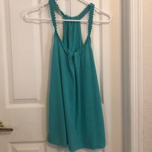 Blue flowy tank top with a braided top neck line